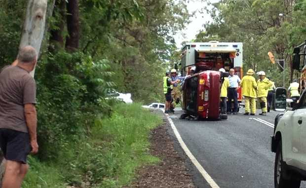 The car on its side after the crash on Diddillibah Rd.