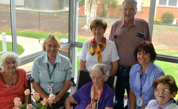 Surat Hospital's Skye Mackenzie (second from right) and Liz Maclean (second from left) meet Unita Butler, Marie and Max Bright (standing) and future residents Nita Henning and Molly Bell in their new building.