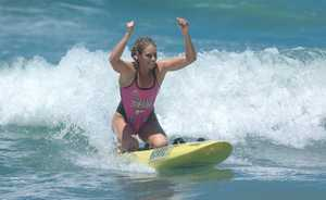 Candice Falzon celebrates an Ironwoman victory
