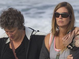 Meg Strange, right, the wife of shark victim Adam Strange, with a family friend at Muriwai Beach yesterday for the blessing. Photo / Brett Phibbs