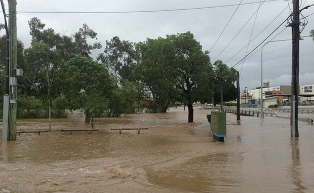 Dalby's Patrick St bridge and surrounding parkland go underwater as Myall Creek floods today.