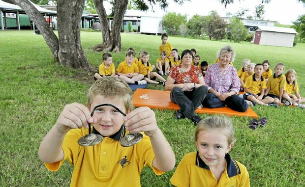 BEING MINDFUL: Blakebrook Public School students Sam Essery, 8 and Josie Pruess, 7, ring bells while the director of Mindfulness in Education Bobbi Allan (centre right) and teacher Lois Skorjenko (centre left) practise some mindfulness techniques with the K-3 class.
