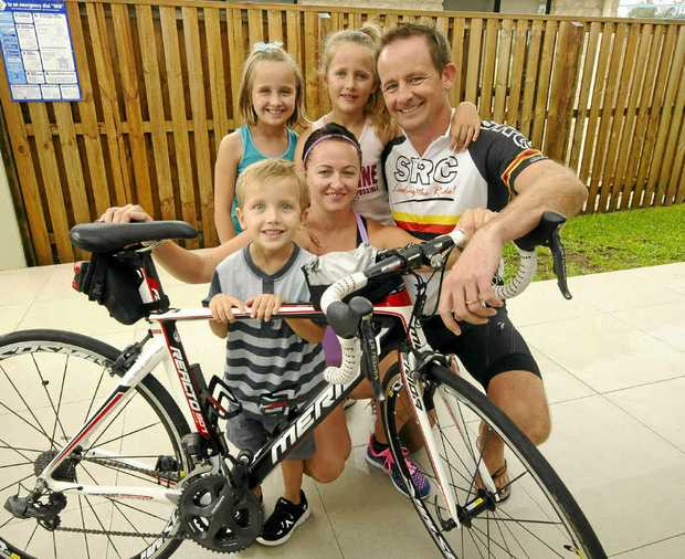 FAMILY SUPPORT: Triathletes Chris and Teresa Barnes with their children Ella, 9, Grace, 7, and Henry, 4. Photo: Doug Eaton