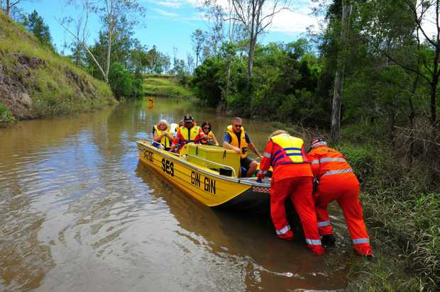 Gin Gin SES volunteers busy ferrying Goodnight Scrub locals across Perry River after flood waters blocked the road.