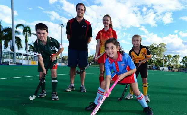 Lachlan Sisley (Frenchville), Dylan Elliott (Regional Coaching Director), Jordyn Watson (Park Avenue), Brock Christensen (Southside United) and front Kyanna Willie (Wanderers). Hook into Hockey program at Kalka Shades, Rockhampton. Photo Sharyn O'Neill / The Morning Bulletin