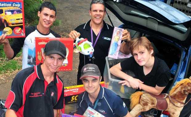 FOR THE KIDS: Anytime Fitness owner Darrin Voss delivers toys donated to kids affected by the flood by members of the club. Damien Harrison, Ross Thorpe, Bailey Jennings and Kai Pais from the Tom Quinn Community Centre lend a hand to unload.