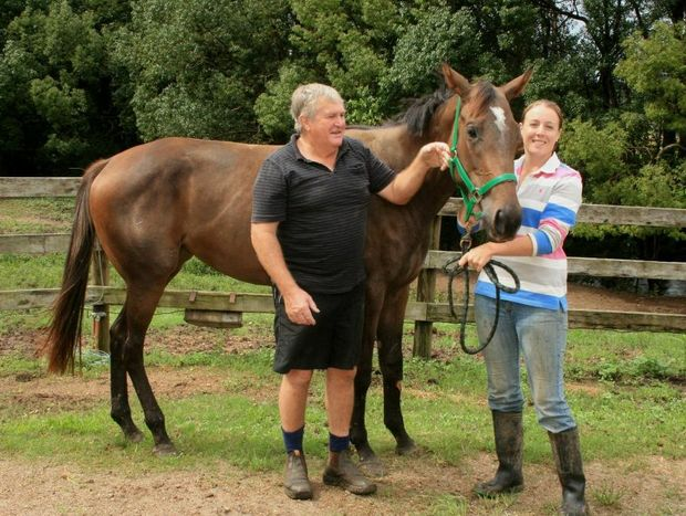 Murray and Mandy McKinnon with Millie, the 2-year-old mare.