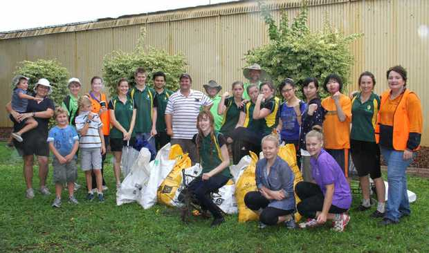 NO MORE RUBBISH: Residents and school students brave the wet weather for Clean Up Australia Day on Sunday.