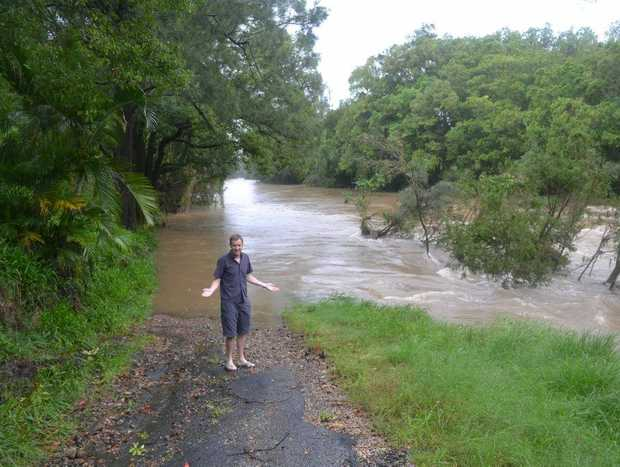 Irish tourist Daragh O'Duffy has never seen flood water like this on the out skirts of Uki.
