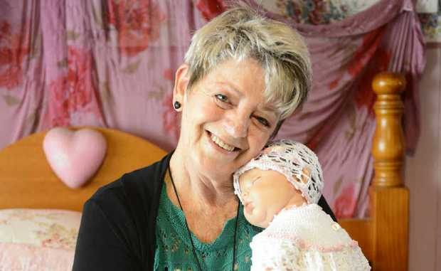 Di McGavigan with one of her realistic reborn dolls. Photo: Adam Hourigan