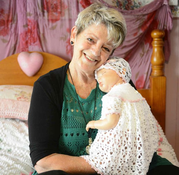Di McGavigan with one of her realistic reborn dolls. Photo: Adam Hourigan
