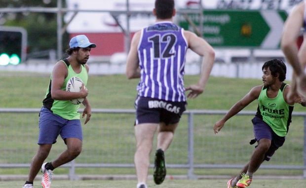 Darumbal player Michael Ray (left) during the Police v Darumbal youth touch football game. Photo: Chris Ison / The Morning Bulletin