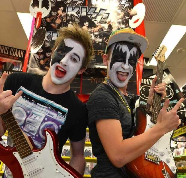 JB Hi Fi staff members Adam O'Connor and Matthew Stephens get into the excitement of this weekend's KISS concert.