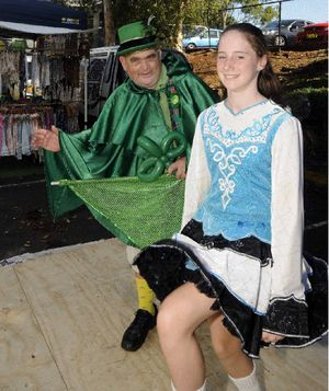 KNEES UP: Ray Parry, of Lismore got into the spirit of St Patrick's Day with Lismore Irish dancer Megan Moore at the Lismore car boot markets yesterday.