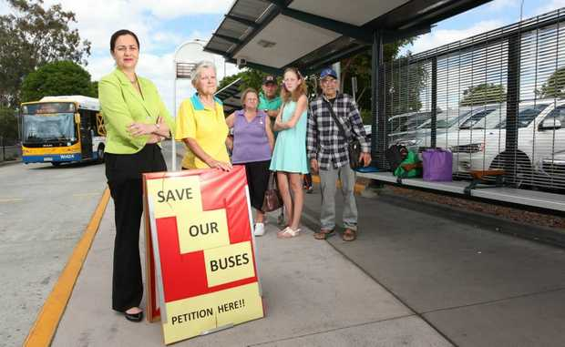Annastacia Palaszczuk and Lynette Colburn with upset residents who are starting a petition to stop bus cuts. Photo: Inga Williams / The Satellite