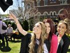 Celebrating graduation day with former University of Southern Queensland student Eleni Tsikleas (left) are sisters Madeleine Tsikleas (middle) and Christina Tsikleas.