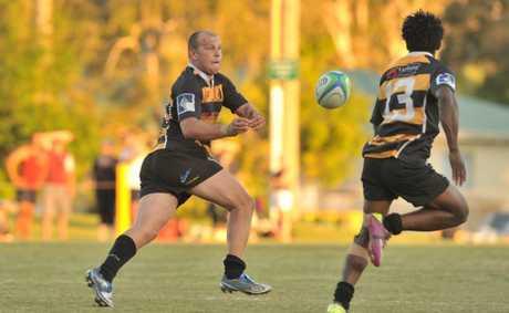 Local rugby union, Caloundra v's Caboolture at Lighthouse Park, Caloundra: Caloundra's Grant Litt offloads.