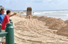 Piles of sand is transported to Maroochydore Beach in time for the Queensland Surf Live Saving Titles today.