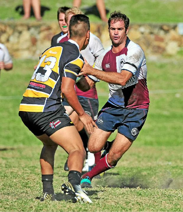 ON THE RUN: The Noosa Dolphins' Chris Massoud shows the ball to his Caloundra opponent at Sunshine Beach yesterday.