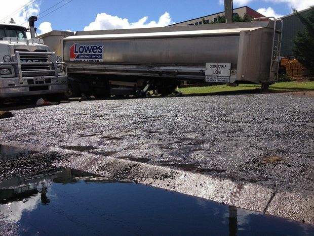 Diesel pools in Boundary St after spilling from a ruptured tanker this morning.