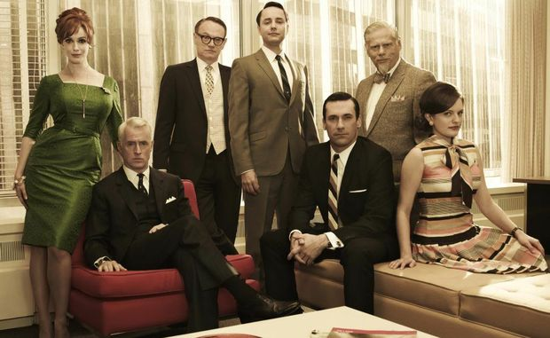 The cast of the TV series Mad Men, from left, Christina Hendricks, John Slattery, Jared Harris, Vincent Kartheiser, Jon Hamm (seated), Robert Morse and