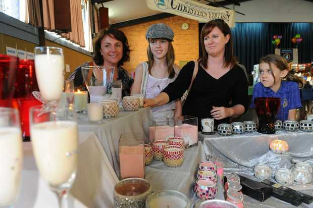 SCENTED CANDLES: Michelle Thomas, Ashlyn Howse, Tammy Howse and Hannah Howse look at the selection of scented candles for sale at the Sew What's Crafty Expo. Photo: Mike Knott / NewsMail