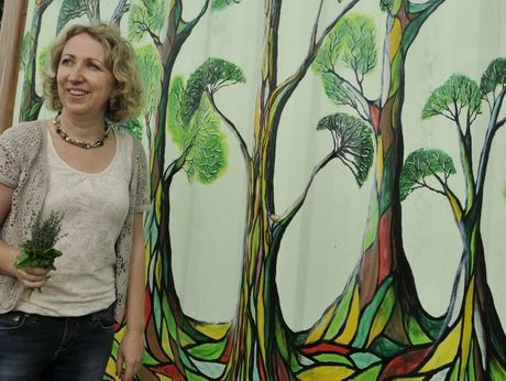 Maud Bagnall has painted French inspired murals at Toowoomba's Community Organic Gardens.