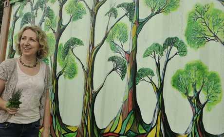 Maud Bagnall has painted French inspired murals at Toowoomba's Community Organic Gardens.