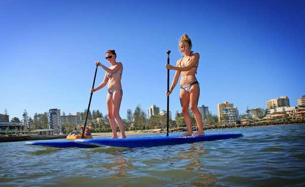 Surfing Champion Brodie Doyle(right) and Leesa Stone go for a paddleboard at Jack Evans Boat Harbour.