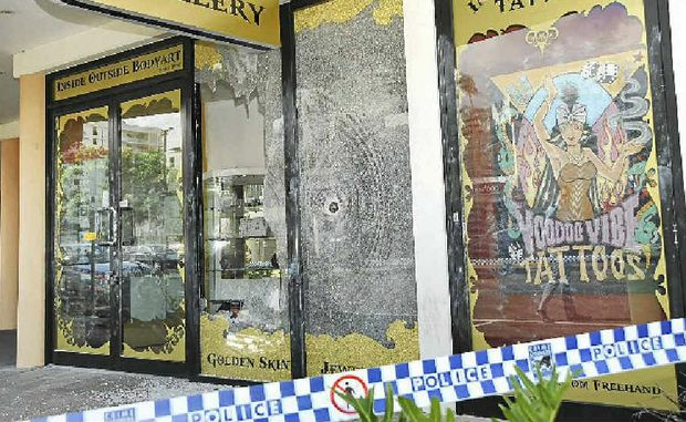 THE DAMAGE DONE: The aftermath of yesterday's attack on the shopfront of a Mooloolaba tattoo business.