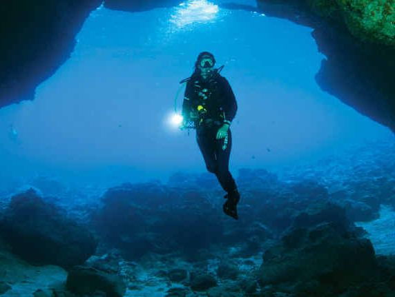 DIVE IN: A scuba diver explores Thundercliff Cave at Christmas Island.