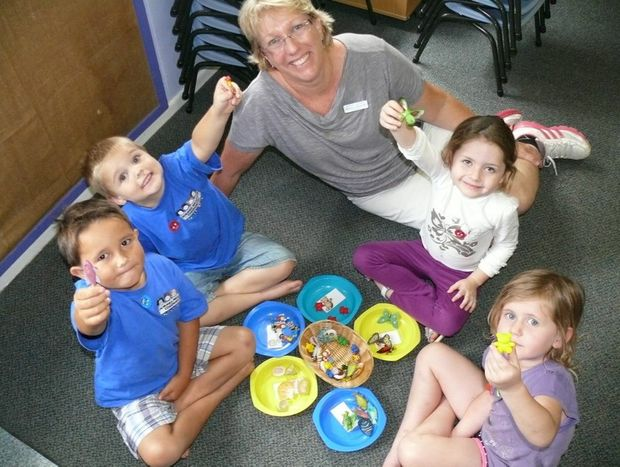 Jacaranda Preschool pupils (from left) Zac Noble-Rogers, Sam Finlay, Cadence Wilkinson-Byrnes and Mahkai Haynes learning how to classify different objects with school director Amanda Lancaster.