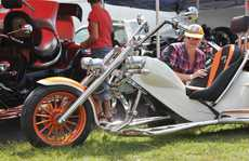 It's no surprise that Mim Dinsmore from Orange, wearing an orange cap, was attracted to a fabulous machine with orange highlights on display at the Ulysses AGM in Maryborough.