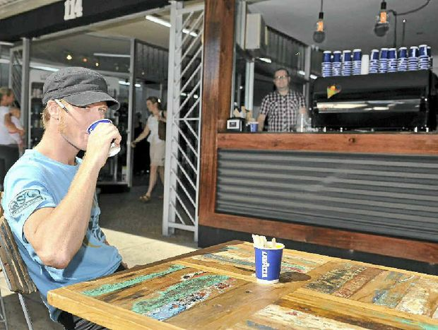 STREET SCENE: Adam Fletcher, barista at the 114 cafe on Keen St in Lismore. In the back Peter Fleming, owner of the cafe.