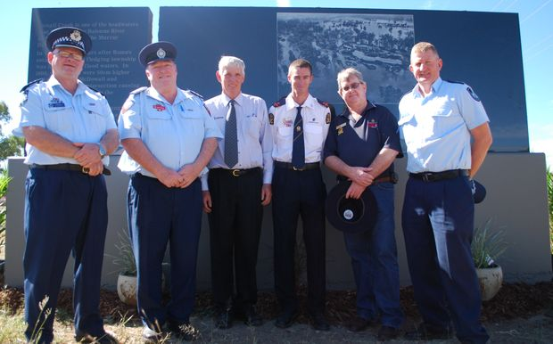 Emergency Service Workers Roger Whyte, Brian Harvey, Bryce Duke, Scott Walsh and Barry Winter with Deputy Mayor Scott Wason at the unveiling of Roma's celebration stone which is in memory of the 2011 Roma floods.
