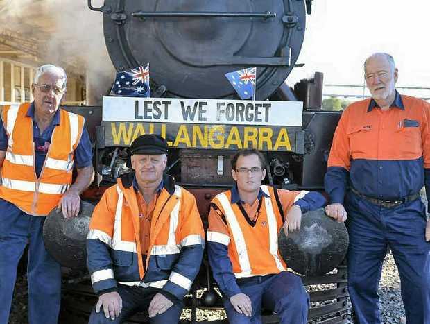 Southern Downs Steam Railway volunteers John Brady, Graeme Geraghty, Stephen Shepherd and driver William Boden prepare to leave the Warwick Railway Station bound for Wallangarra yesterday.