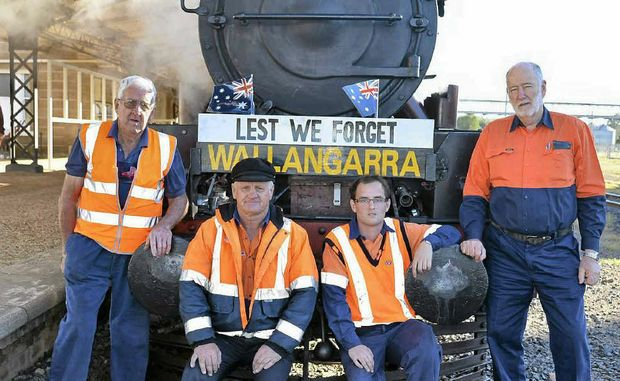 Southern Downs Steam Railway volunteers John Brady, Graeme Geraghty, Stephen Shepherd and driver William Boden prepare to leave the Warwick Railway Station bound for Wallangarra yesterday.