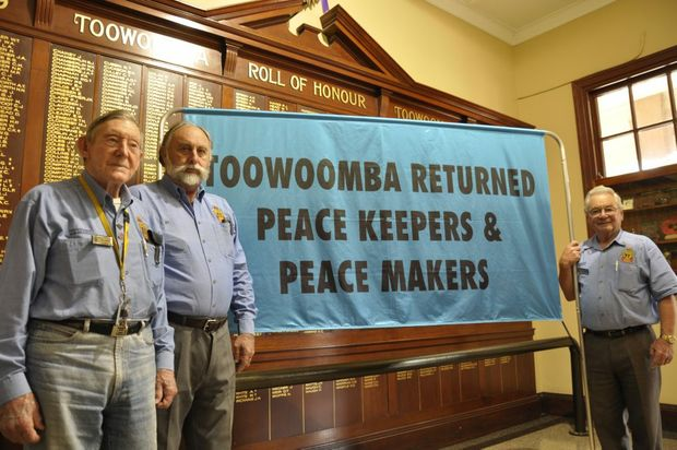 Presenting the Toowoomba Returned Peacekeepers and Peacemakers banner are (from left) Joe Treers, Ed Beningfield and Lindsay Morrison.