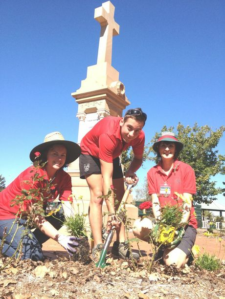 Bunnings staff (from left) Debby Harrison, Dan Pfingst and Steph McIntyre get to work at the Drayton Soldiers Memorial.