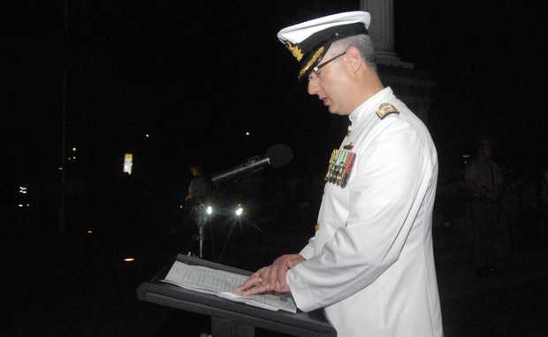 Commodore Peter Quinn RAN addresses the crowd at Mackay's Anzac Day dawn service