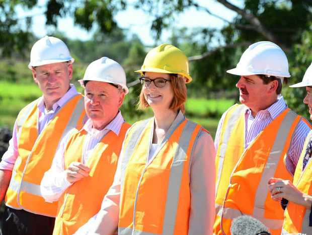 BROUGHT FORWARD: Prime Minister Julia Gillard yesterday announces $300m in funding for two new lanes and a 1.6km bridge across the Yeppen floodplane.