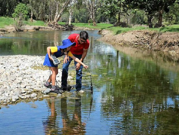 RIVER KNOWLEDGE: Ella Ukkola learns how to conduct on-site water testing to assess the health of creeks and rivers from Fitzroy Partnership for River Health executive officer Nathan Johnston.