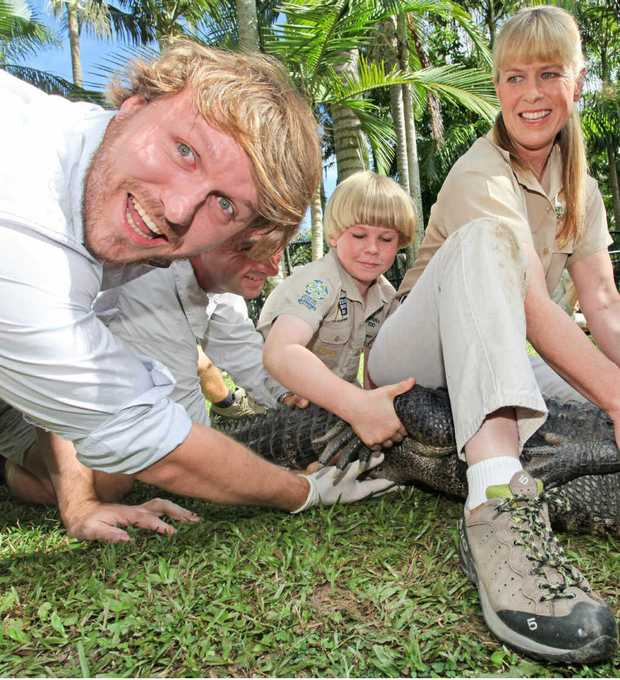 Patrick Williams gets up close and personal with an alligator at Australia Zoo.