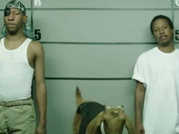 A still from the advert showing the line up of suspects.