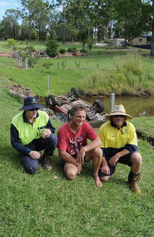 Chris Bern, Russell Reinikka and Brett Whiteway share a laugh after Mr Reinikka's rescue.