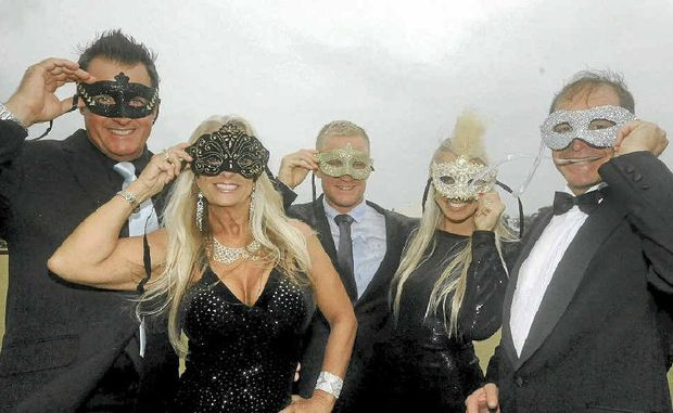 MASQUERADE BALL: James Armstrong, Tracey Everingham, pro surfer Adam Melling, Jaymin Perkins and Pip Carter ready for a fundraising ball.