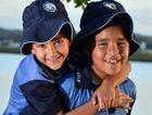TAKING THE BUS? Kawana twins Livai and Tara Sokovagone feature on Sunbus advertising their school.