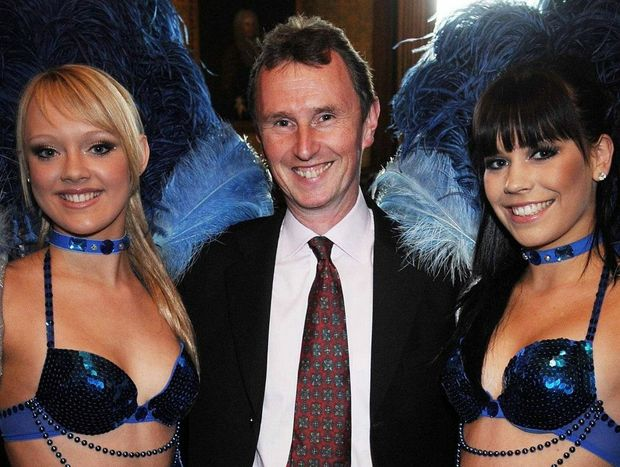 Arrested: Deputy Speaker Nigel Evans with dancers who visited the House of Commons in 2008