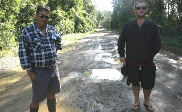 Commercial anglers Laurie Birks (left)and Craig Wraight say the Brunswick Heads boat ramp road is damaging their boats and placing their livelihoods at risk.
