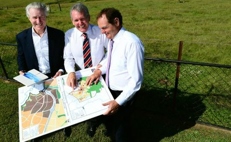 Sekisui House director Stephen Williams explains details about the Ripley Valley development to Energy and Water Supply Minister Mark McArdle (centre) and Mayor Paul Pisasale.